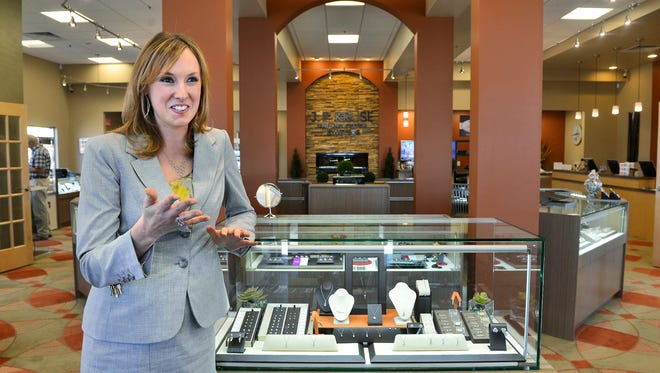 Melissa Kelley, co-owner of J.F. Kruse Jewelers in St. Cloud, talks Tuesday about how she loves helping couples pick out the perfect ring and hearing their stories of how they got engaged. Kelley, the youngest daughter of founder Jim Kruse, is being honored with her father as Minnesota's Small Business Person of the Year and will compete for a national title.