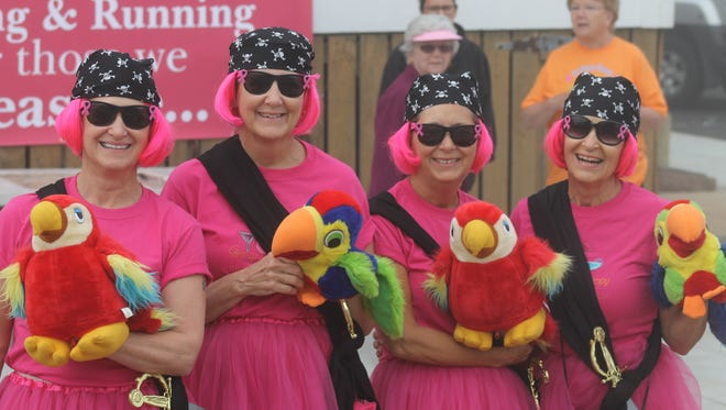 "Jeannette Whiteford, Sandy Cook, Sharon Miller and Wanda Edie, known as ""The Pink Ladies, dressed in matching pirate costumes in the 2014 Bethany Beach Breast Cancer run."