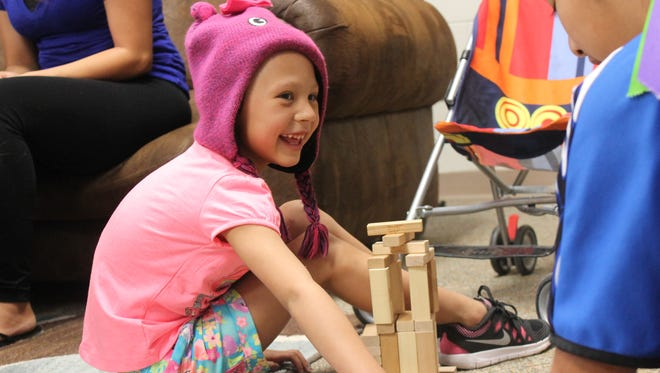 Kylie Beach, 5 years old, plays with her older sister on Wednesday afternoon. Kylie was underwent surgery for a two pound Wilms tumor in her kidney.