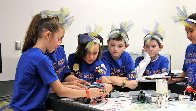 Buena Vista Superheroes, a local First Lego League team, works together during the Alamogordo FLL Qualifier in January. The team is slated to attend the North American Invitational in Carlsbad, California in May, if they can raise $8,000 for the trip.