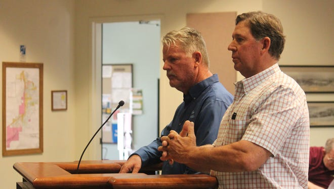 Traffic Control Specialist Dan Lurtsema (L) and Chamber President GB Oliver presented parking plans for the July 4 festival.