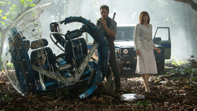 Chris Pratt and Bryce Dallas Howard assess the damage in 'Jurassic World.'