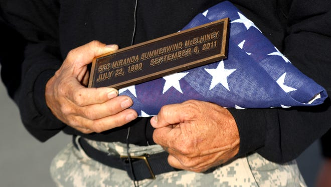 Ken Curtzwiler, 59, a retired major with the Nevada Army National Guard, shows off a plaque and a folded American flag on Sunday in remembrance of his 31-year-old daughter, Sgt. 1st Class Miranda Summerwind McElhiney, who was killed on Sept. 6, 2011 in a shooting at an IHOP in Carson City.
