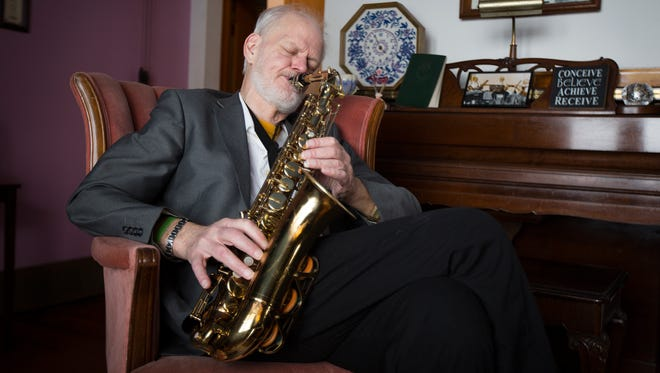 Ray Crammond plays the saxophone at his house in Ankeny, Wednesday, Feb. 10, 2016. Cramming received a double lung transplant on June 27, 2013.