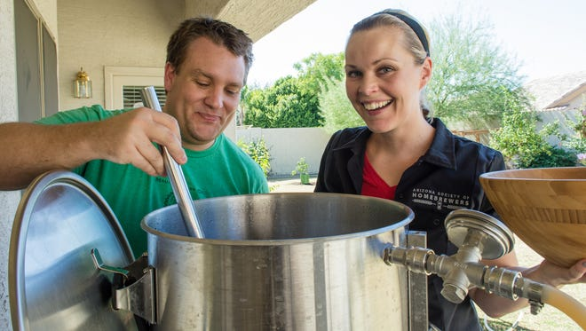 Danielle Schanke and husband Mike Bush brew a chocolate milk stout in their three-barrel home brewing system on Oct. 8, 2016.
