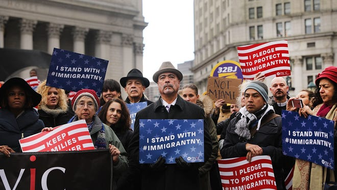 Area Muslims and local immigration activists participate in a prayer and rally against President Donald Trump's immigration policies on January 27, 2017 in New York City. President Trump has taken actions since the inauguration to start the building of a long promised wall along the Mexican border and to cut federal grants for immigrant protecting 'sanctuary cities'.
