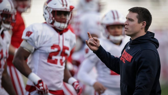 Wisconsin defensive coordinator Jim Leonhard works with the team during practice before the annual spring game at Camp Randall on April 21, 2017.