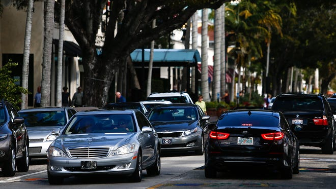 Motorists make their way up and down Fifth Avenue South in Naples on Monday, January 25, 2016.