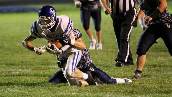 Chillicothe's Zach Coats fights for extra yards during the Cavaliers' season-opening 31-27 win at Teays Valley. Coats' Cavaliers will end their regular season Friday night at Jackson.