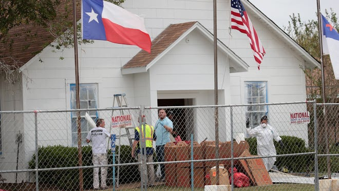 Workers patch bullet holes and paint the exterior of the First Baptist Church of Sutherland Springs on Nov. 9, 2017 in Sutherland Springs, Texas.