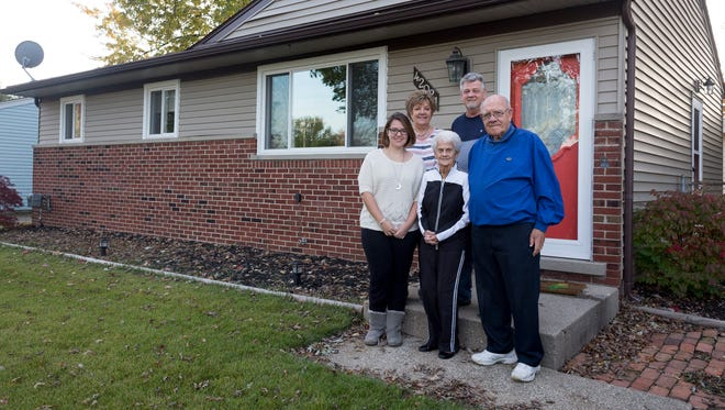Amber Hauer, left, stands outside her new house in Sterling Heights with her parents, Denise and Eric Hauer, and her grandparents Barb and Don Plotzka, who helped her buy it, on Nov. 3, 2017.