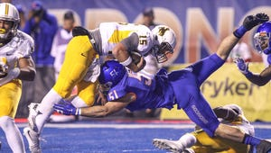 Quarterback Nick Smith of the Wyoming Cowboys and linebacker Ben Weaver of the Boise State Broncos meet at the goal line during second half action on October 24, 2015, at Albertsons Stadium in Boise, Idaho. (Photo by Loren Orr/Getty Images)