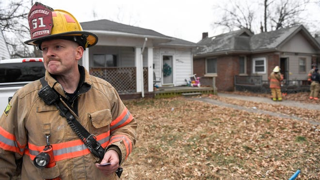 Evansville Fire Investigator Eric Eifert talks to the media at the scene of a house fire at 821 Taylor Avenue Sunday, January 7, 2018.