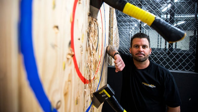Francesco DiNardo, co-owner of LumberjAxes in Tempe, said the sport of ax-throwing is like darts, but more extreme.