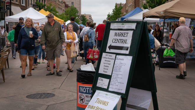 The Oshkosh Farmers Market opened for the summer in the downtown Main Street location on Saturday, June 2, 2018. Despite cool temperatures and an overcast sky, hundreds of people browsed the market.