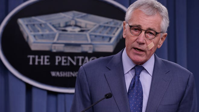Defense Secretary Chuck Hagel announces a series of reforms to the troubled nuclear force during a press briefing at the Pentagon on Nov. 14, 2014.