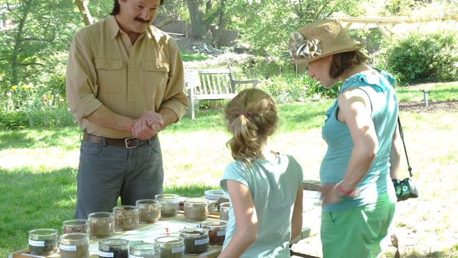 USDA-NRCS soil scientist Fred Schoenagel discusses New Jersey's variety of soil types with attendees at Macculloch Hall Historical Museum's National Public Gardens Day festivities on May 8.