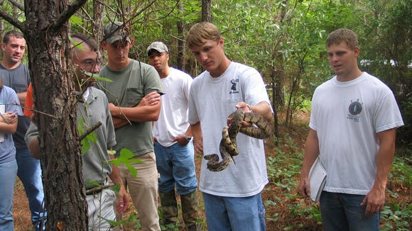 Among the many activities one can participate in during National Wildlife and Fishing Day is holding a live snake.