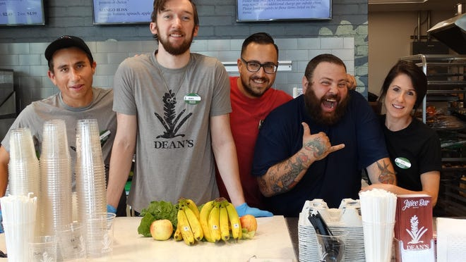 Juice Bar team members (left to right) Giovanni Iemmello, James Hartman, Adam Simmons, Scott Sleckman, and Jennifer Wenger welcome customers to Dean's Natural Food Market during the store's grand opening in Chester on July 16.