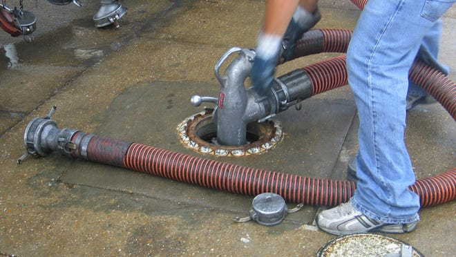 07/06/2007 a3 A worker with Castle Creek LLC of Shreveport fills an underground gas storage tank at a Circle K store in Pineville. David Dinsmore/ddinsmore@thetowntalk.com