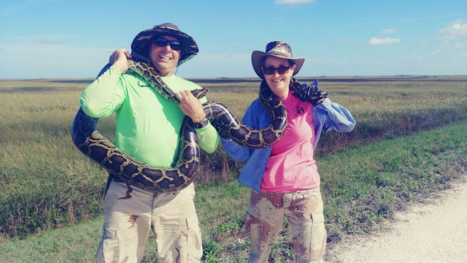 Dave Mucci, left, won $1,000 for capturing an 11-foot, .08-inch python during the 2020 Florida Python Bowl. At least 80 invasive Burmese pythons were removed from the Everglades during the 10-day competition.