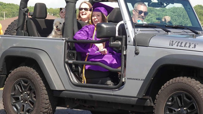 Most of the cars with families driving their 2020 Jackson Local graduate to the special drive thru ceremony on May 28 were decorated including one truck with a cap on the roof and a diploma on the hood with the graduate and her family inside.