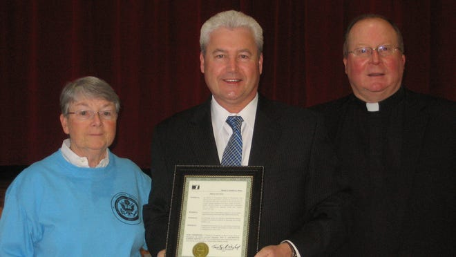 From left to right are Sister Merris Larkin, Assumption School principal, Morristown Mayor Tim Dougherty and Monsignor John E. Hart of the Church of the Assumption of the Blessed Virgin Mary