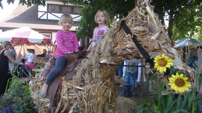 Sami Bigbee sits on a cornstalk horse with her sister Sophie standing behind her at Wickman's Fall Festival last year.