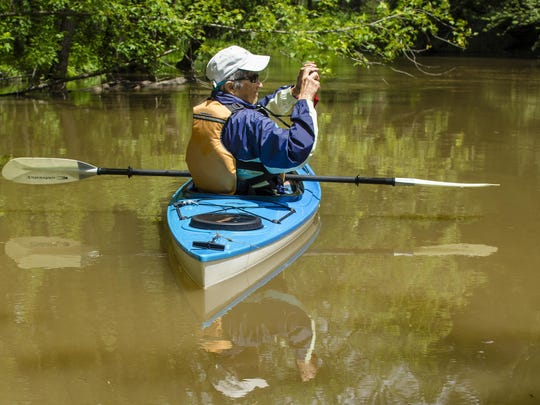 Kathy Frank paddles and takes photos along the LaPlatte River in Shelburne.
