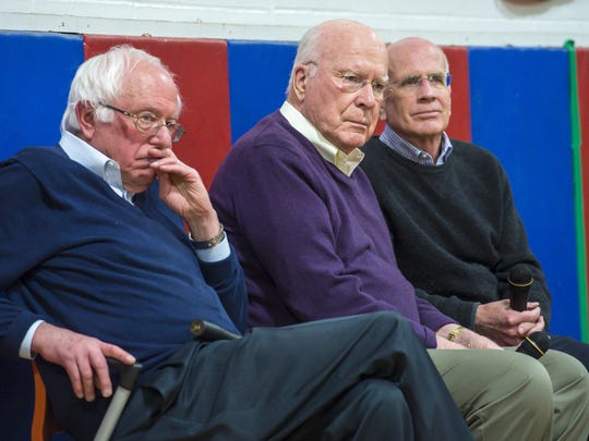 Vermont's congressional delegation, from left, Sens. Senators Bernie Sanders and Patrick Leahy, and U.S. Rep. Peter Welch listen to a question from an audience member during a town hall meeting at Hazen Union High School in Hardwick on Saturday.
