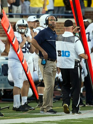 Penn State head coach James Franklin, center, looks up at the scoreboard in the fourth quarter during a 49-10 loss at Michigan during the 2016 season. The Nittany Lions have gone 15-1 since that humbling defeat.