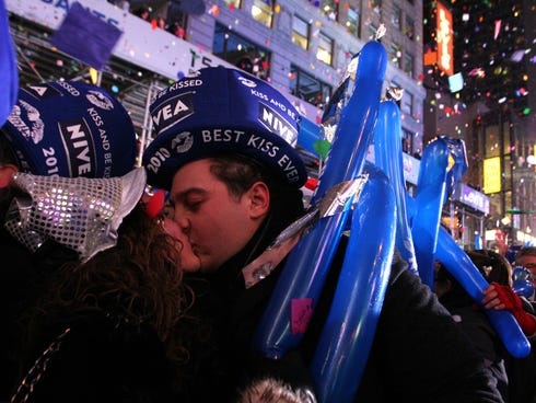 Maria Perremuto, left, and her boyfriend, Mike Socolick, both of the Staten Island borough of New York, share a kiss shortly after midnight while ringing in 2010.