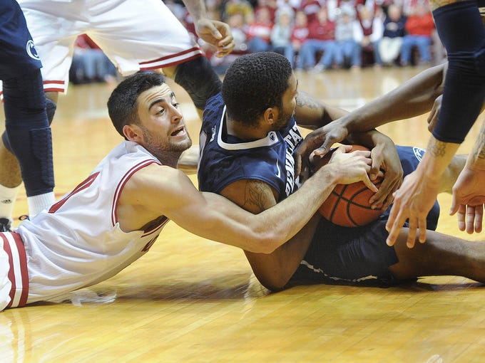 Will Sheehey of IU tries to get to a loose ball picked up by PSU's D. J. Newbill in the second half. Indiana University lost to Penn State 66-65 in a Big Ten basketball game at Assembly Hall in Bloomington Wednesday February 12, 2014.