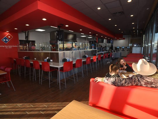 Kathy Roberts and her family dine in at the new Domino's location on Wednesday at 500 W. Broadway Ave. in Bloomfield.