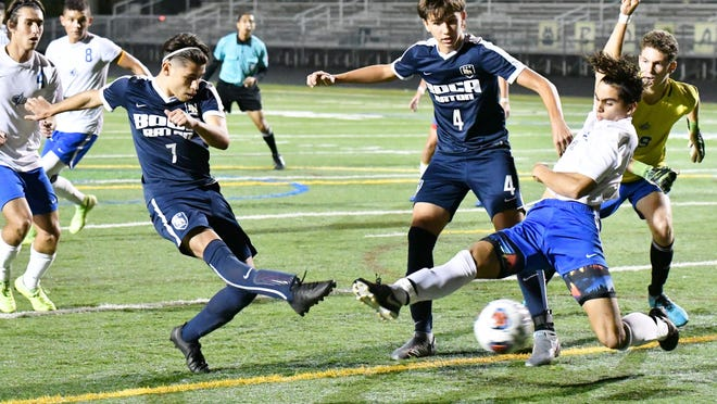 Boca Raton's Daniel Lvov buries a deflected shot in the back of the net against Cypress Bay on Saturday. It was the team's first of two goals, and the Bobcats didn't look back, advancing to the program's first state championship in four years.