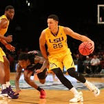 LSU Tigers forward Ben Simmons (25) drives past North Carolina State Wolfpack guard Anthony Barber (12) during the second half in the consolation game of the Legends Classic at Barclays Center. North Carolina State Wolfpack won 83-72 in overtime.