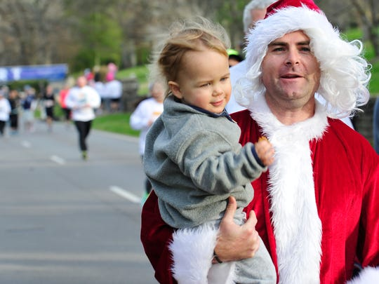 Steve Walsh and his son James walk during the 22nd annual Boulevard Bolt Thanksgiving Day race.