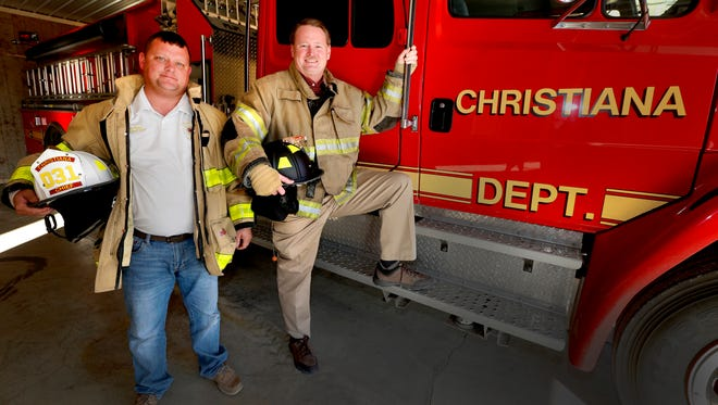Mike Tapp, left the fire chief for Christiana' volunteer fire department with Dewayne Sadler, a Christiana volunteer firefighter and outgoing President for the group, on Wednesday Nov. 29, 2017,