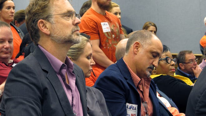 Actor John Schneider, who owns a film production studio in Livingston Parish, listens to House Ways and Means Committee debate on a bill to scale back Louisiana's film tax credit program, on Tuesday, April 28, 2015, in Baton Rouge, La. (AP Photo/Melinda Deslatte)