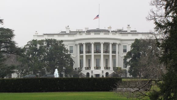 White House with flag at half staff following shootings