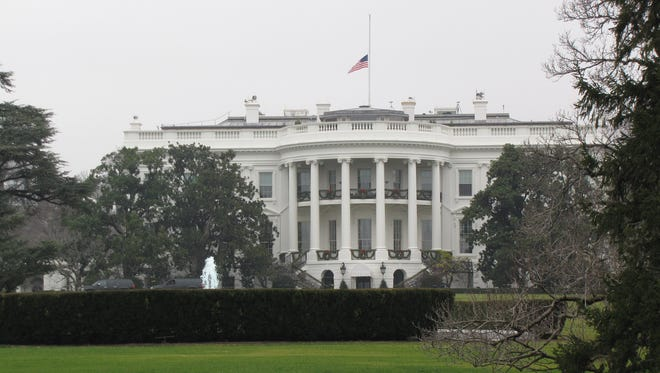White House with flag at half staff following shootings at Sandy Hook Elementary School