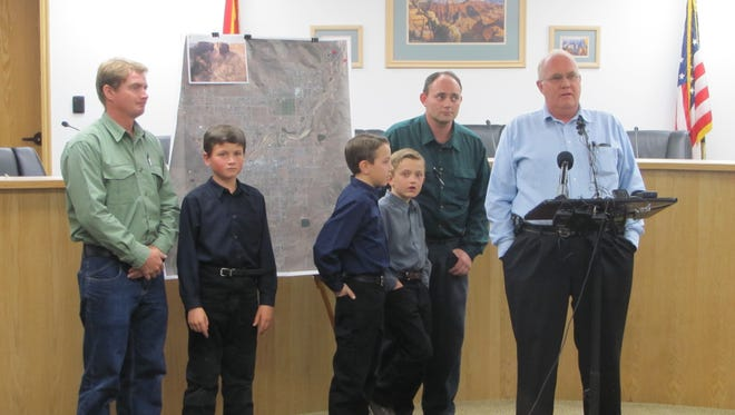 Hildale Mayor Philip Barlow, right, stands with Sheldon Black Jr., second from right, and Joseph Jessop, left, and the three boys who survived Monday's deadly flash floods at a press briefing Thursday in Colorado City.