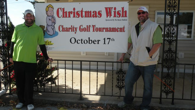 David Butterfield and Brad Heinsohn are the winners of the men's flight at the Christmas Wish Charity Golf Tournament held Oct. 17 at Twin Lakes Golf Course.
