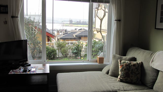 A basement apartment in Seattle's Eastlake neighborhood looks onto Lake Union. The property rents for $135 a night on the website Airbnb.com.