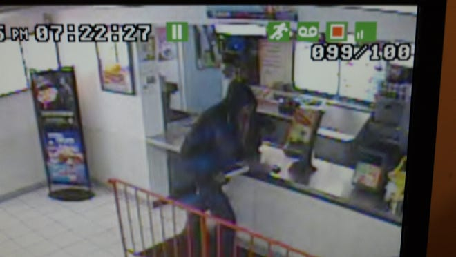 Police have released a photo of the sword-wielding suspect who robbed the Port Huron Dairy Queen Tuesday.