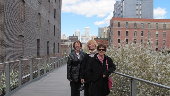 Neshanic Garden Club members (from left) Diana Reinhardt, Georgette Migliore and Lynn Marley walk in New York City's High Line public park, once an elevated freight rail line. The park has enhanced the surrounding neighborhood for several years.