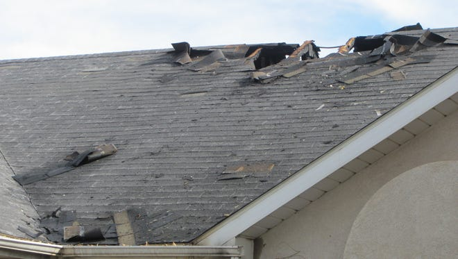 Roof damage is shown at a unit of The Cottages association in South St. George Wednesday after an early-morning fire displaced a resident.