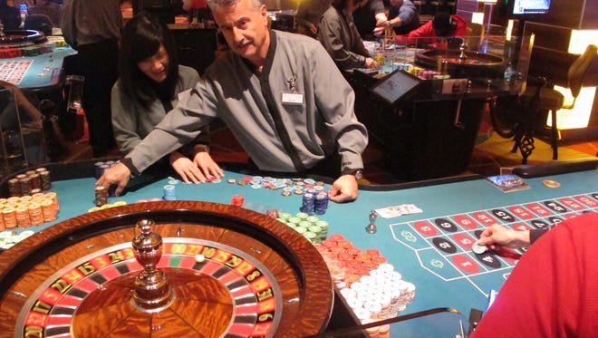 A dealer runs a game of roulette at the Tropicana casino in Atlantic City earlier this month. Figures released Monday  show Atlantic City's casinos won $204.7 million in February 2016, an increase of 14.7 percent from February 2015.