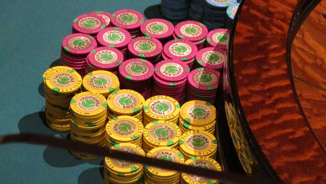 This March 9, 2016 photo shows stacks of chips at the Tropicana casino in Atlantic City, N.J. When voters go to the polls in November to decide a statewide referendum on expanding casinos to the northern part of the state, they will likely only have a vague idea of what they're voting on as key details are not likely to be decided until after the referendum.