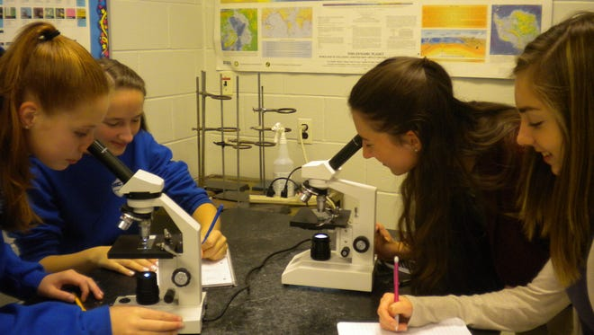 Cumberland Christian School students work with microscopes. To learn more about the school, plan to attend an open house there on April 7 or 14.